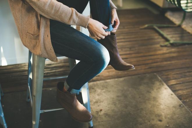 Girl in denim cuffing pants