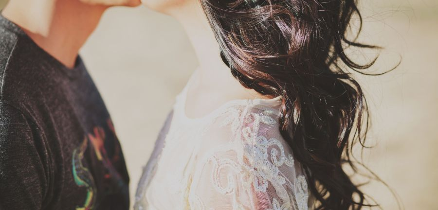 pic of couple kissing women wearing lace dress