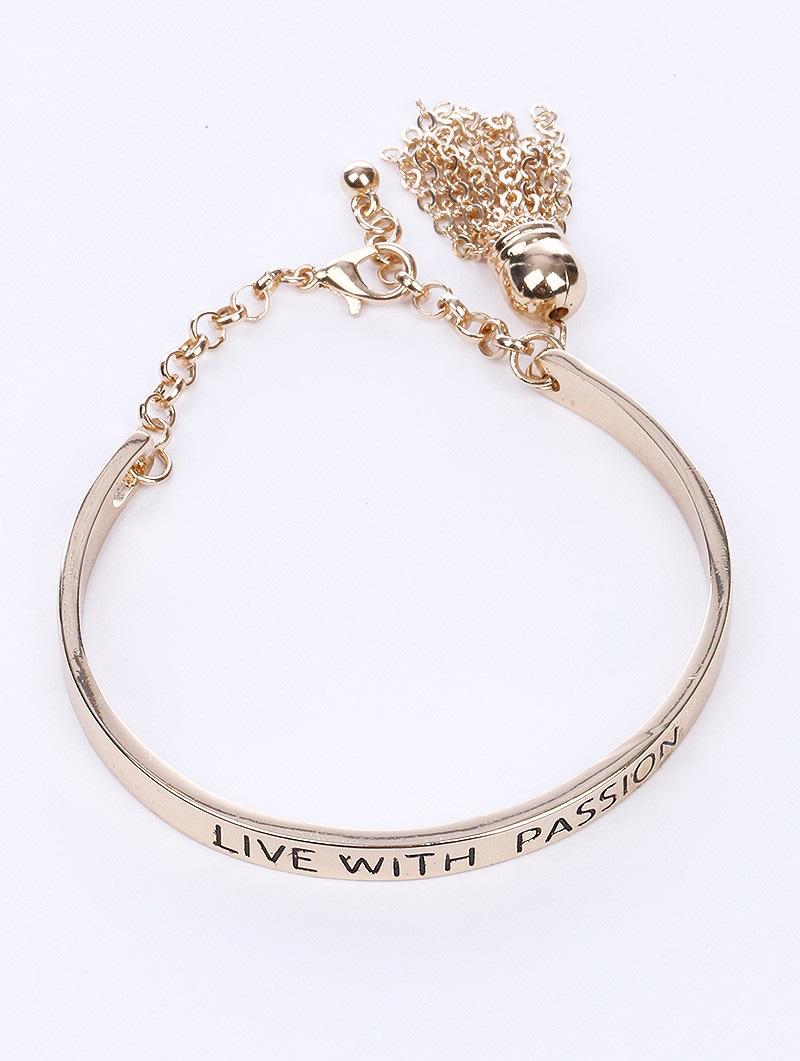 "gold bangle bracelet that reads, ""Live With Passion"" Blue Labels Boutique"