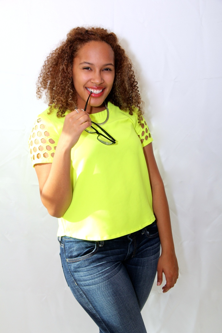 pic of neon green short sleeve top with jeans