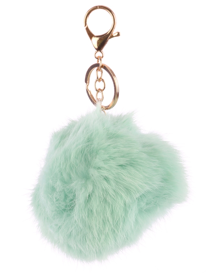 pic of mint green fur ball bag accessory blue labels boutique