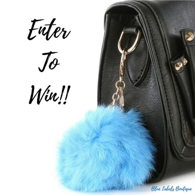 picture of handbag accessory, fur ball accessory, blue labels boutique