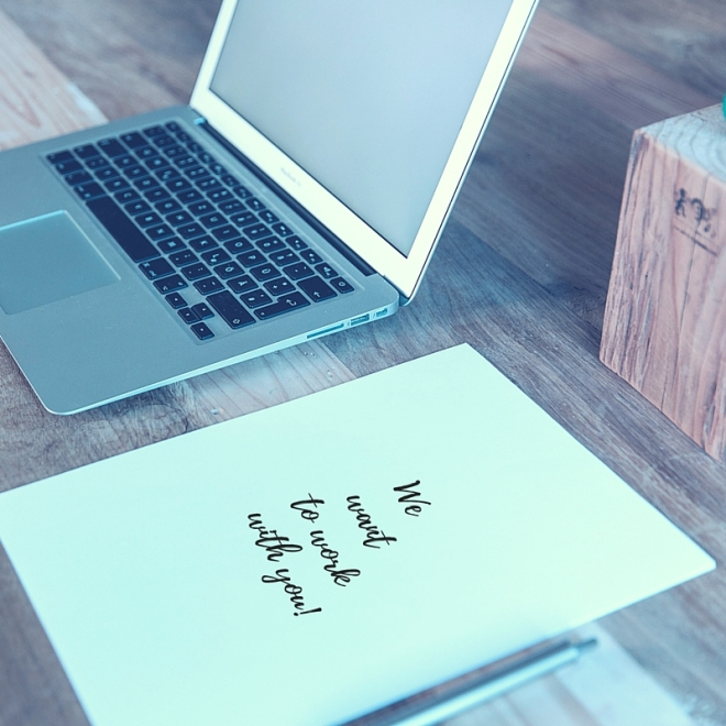 pic of laptop & paper-blue labels boutique - advertise with us