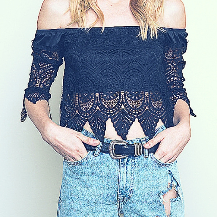 model wearing black crochet off shoulder top and ripped jeans