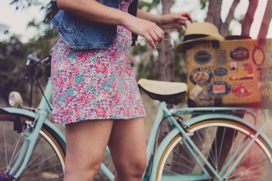 floral printed skirt with girl standing by bike