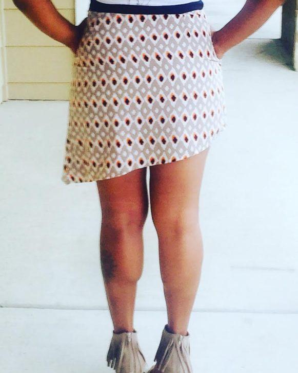 printed mini skirt with asymmetrical hem