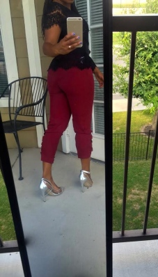 burgunday pants black lace top spiked belt silver shoes