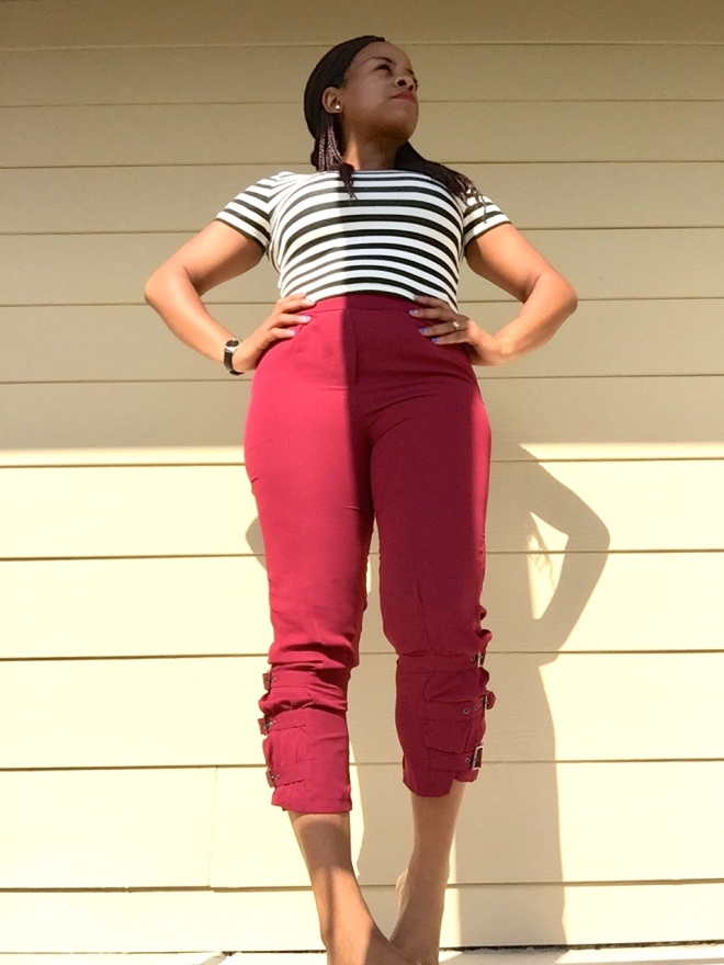 burgundy trousers with black and white striped crop top