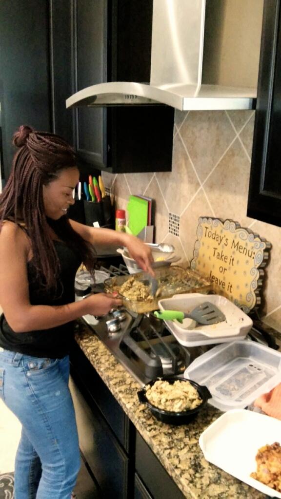 pic of black women at stove making food
