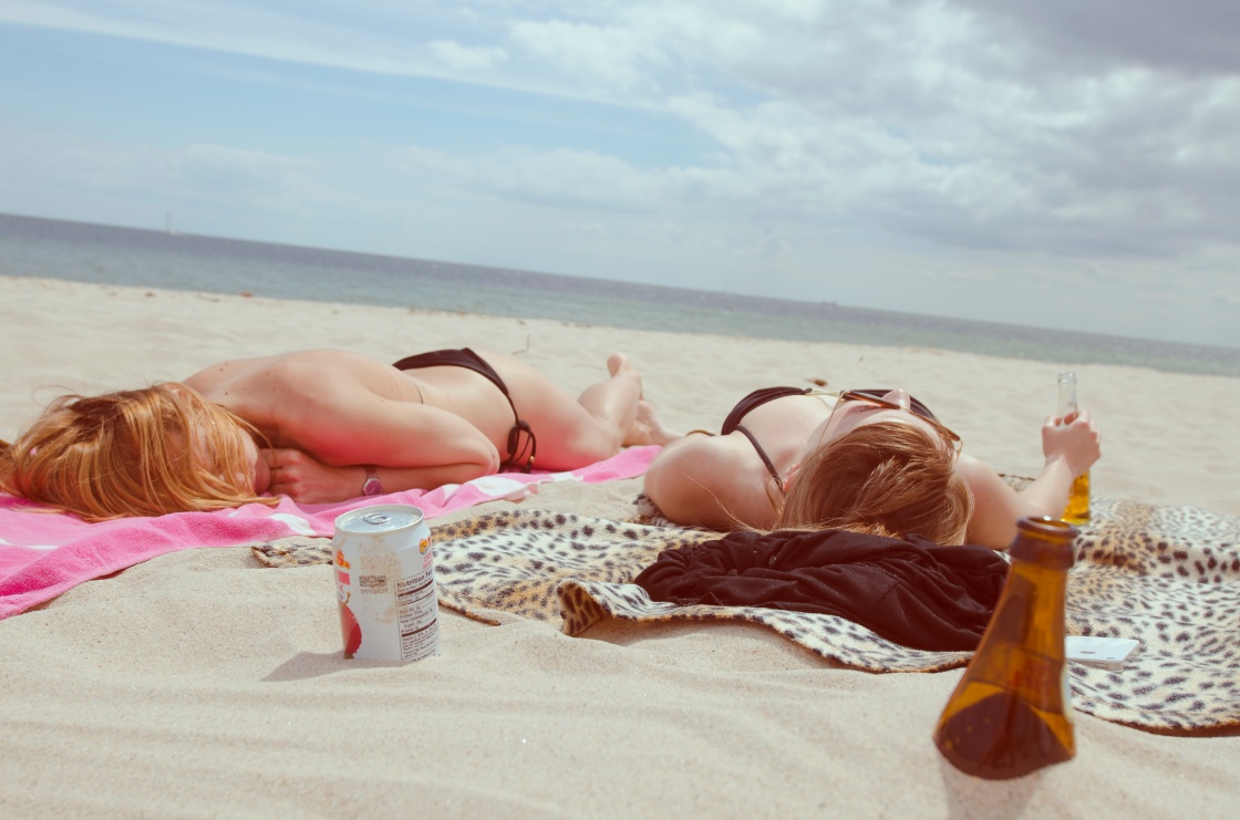 girls laying on the beach