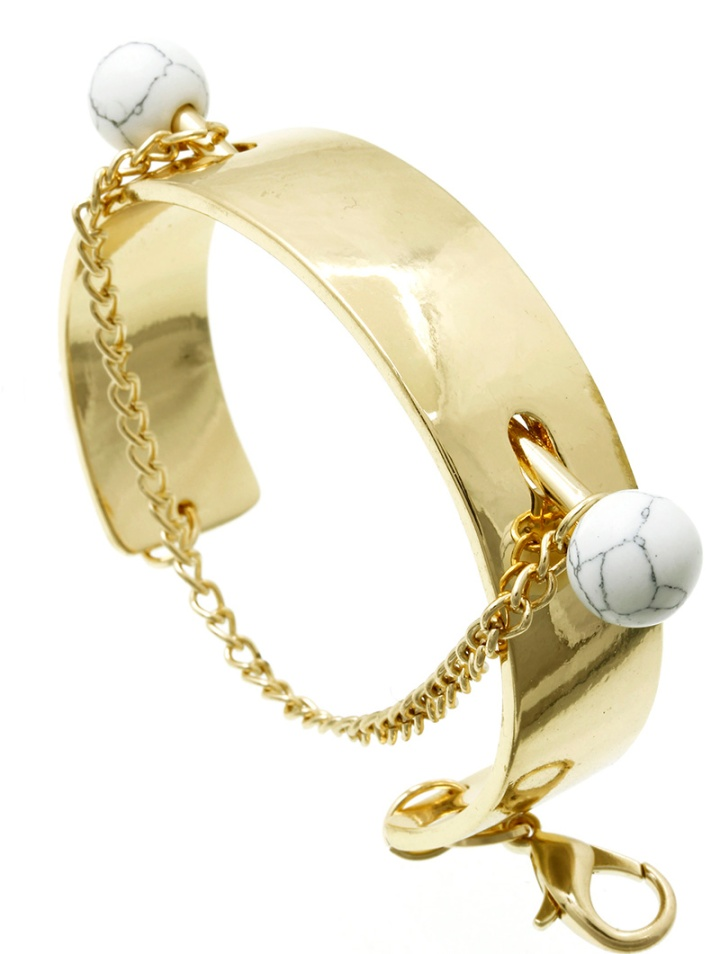 gold cuff bangle with marble accents blue labels boutique