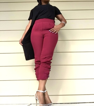 black high low top burgundy pants silver shoes