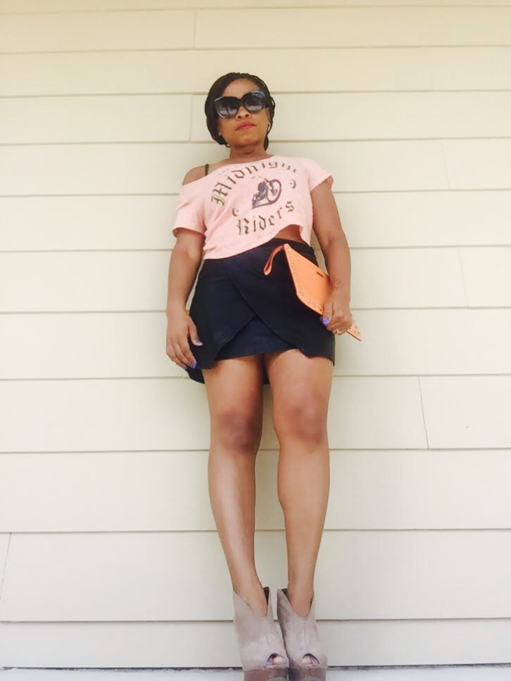 crop top, black faux leather wrap skirt, orange clutch