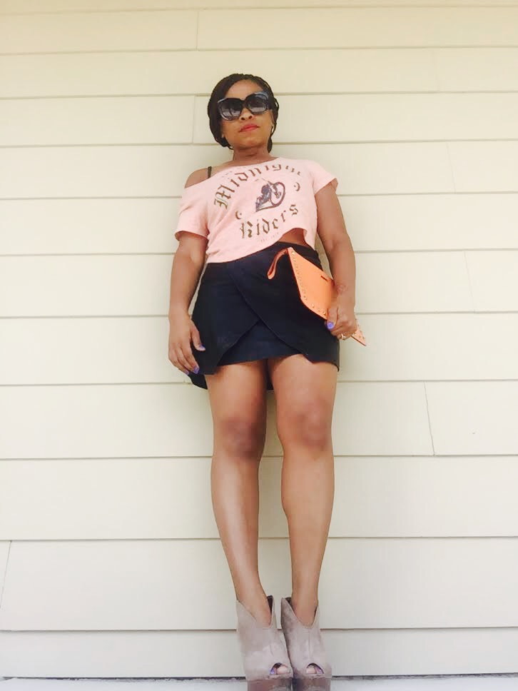 crop top, black faux leather wrap skirt, orange clutch