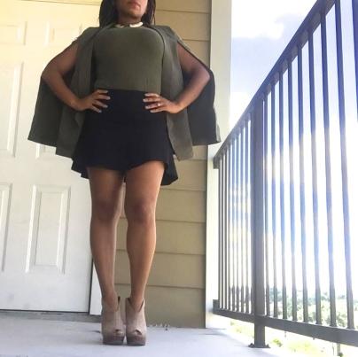 olive cape blazer black mini skirt tan booties gold necklace