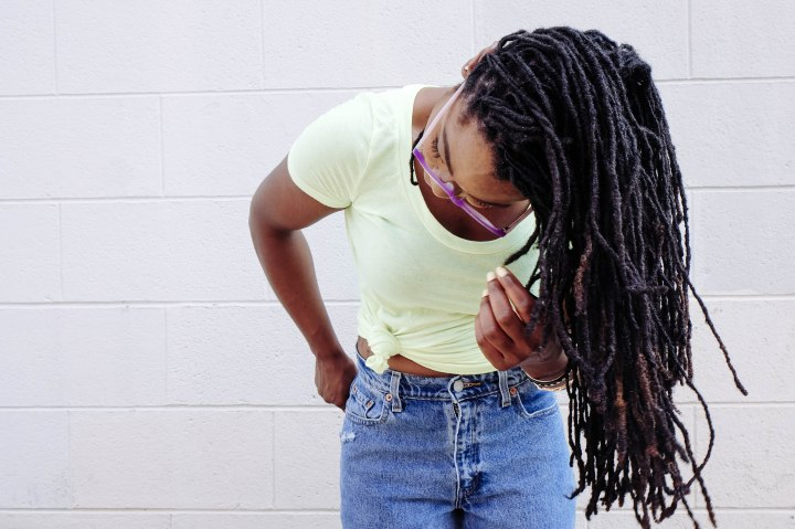 black girl swinging dreadlocks