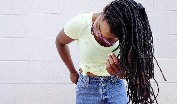 black girl swinging dreadlocks