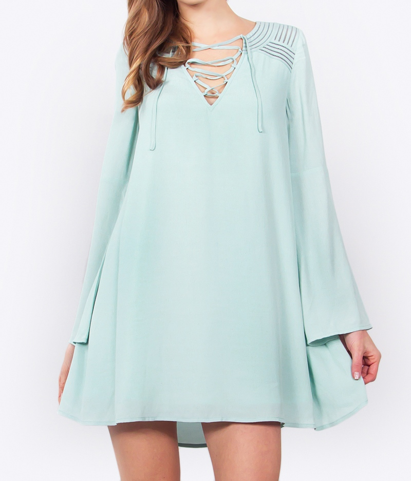 mint colored dress with bell sleeves blue labels boutique