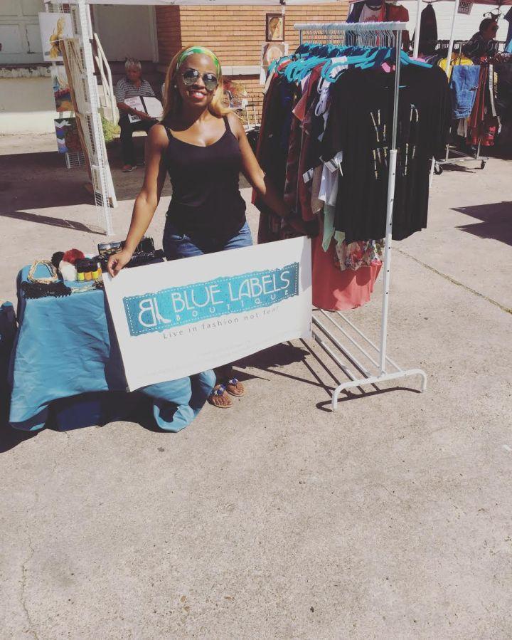 pic of BLB owner holding sign at vendor show