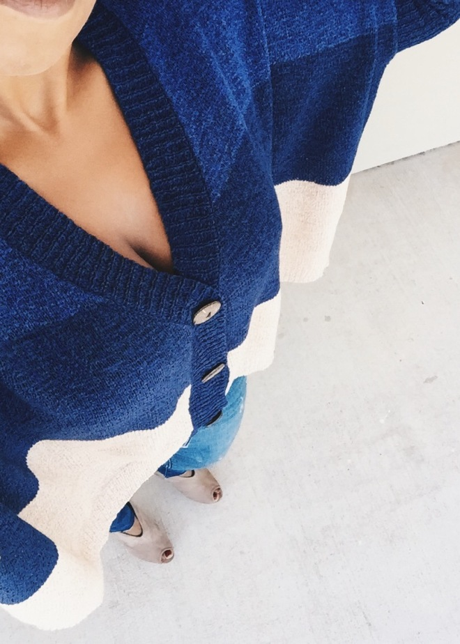 wearing color block sweater blue labels boutique