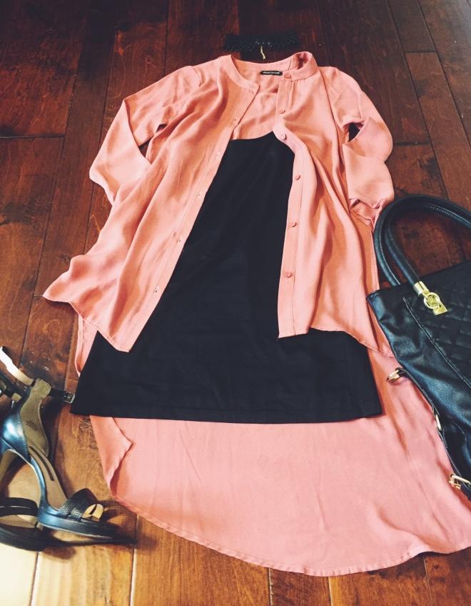 blush top with black cami dress underneath blue labels boutique