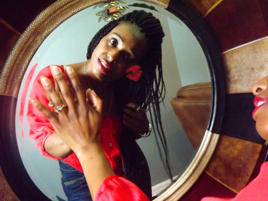 black women kissing herself in the mirror