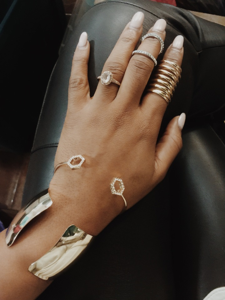 hand wearing gold stack rings