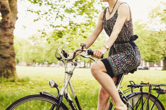 girl riding bike in a dress