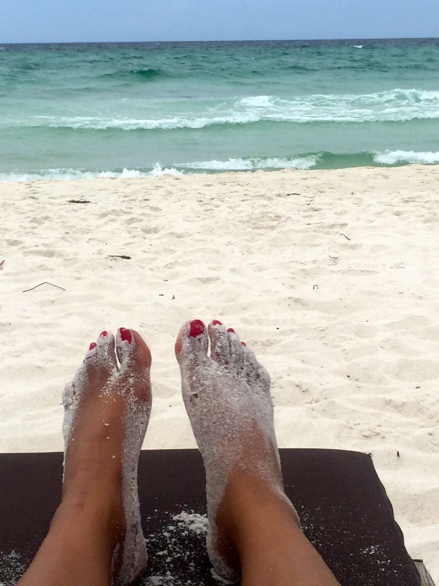 feet lounging at the beach