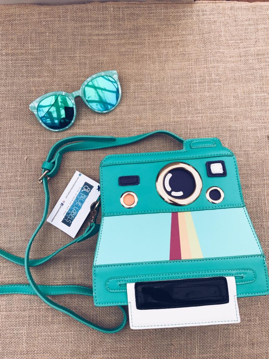camera bag and sunglasses blue labels boutique