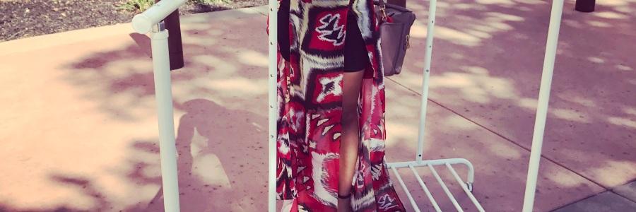 girl rolling clothing racks through mall