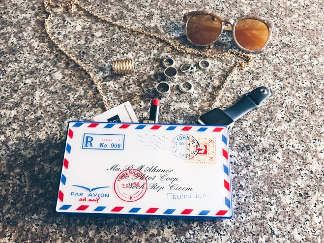 postcard clutch blue labels boutique