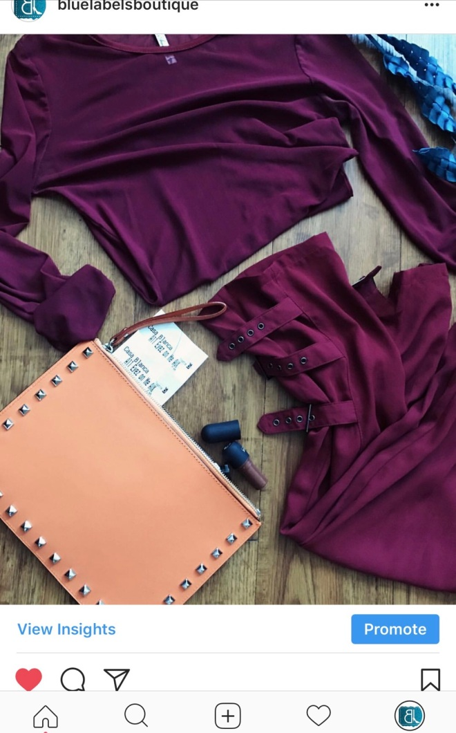burgundy top, burgundy pants, orange clutch, blue labels boutique