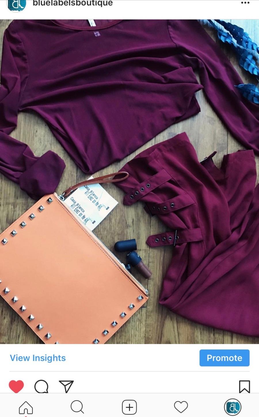 burgundy top, burgundy pants, orange clutch, blue labels boutique