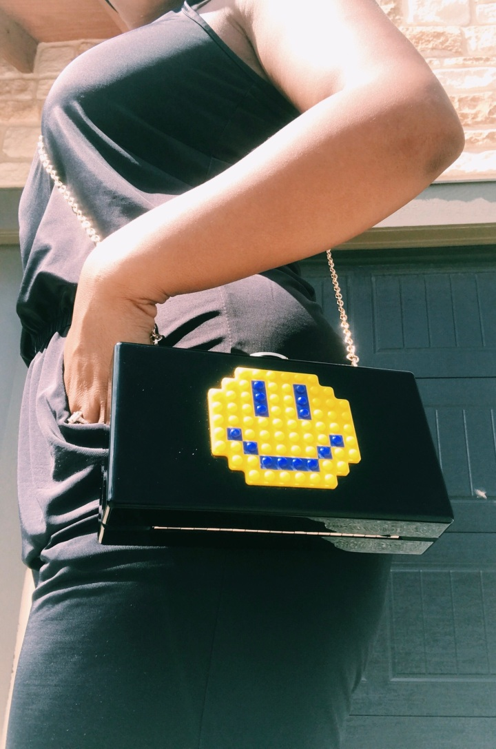 black clutch bag with smiley face blue labels boutique
