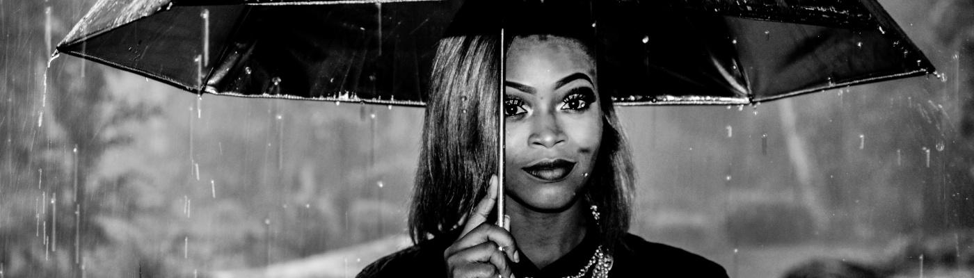 black women under umbrella