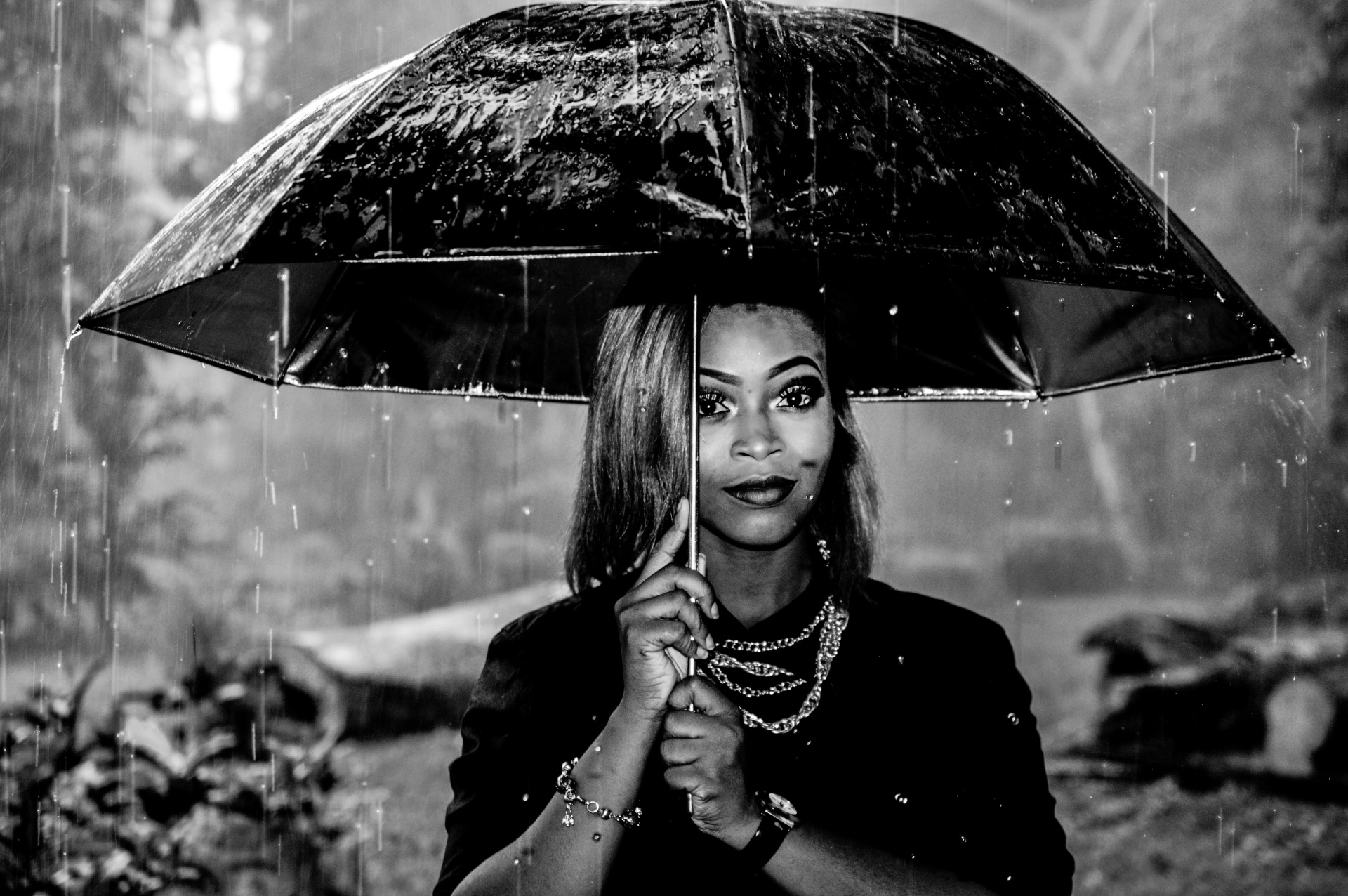 black women under umbrella
