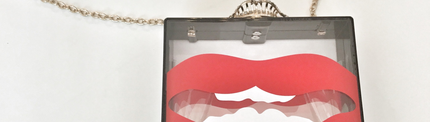 box clutch with lips blue labels boutique