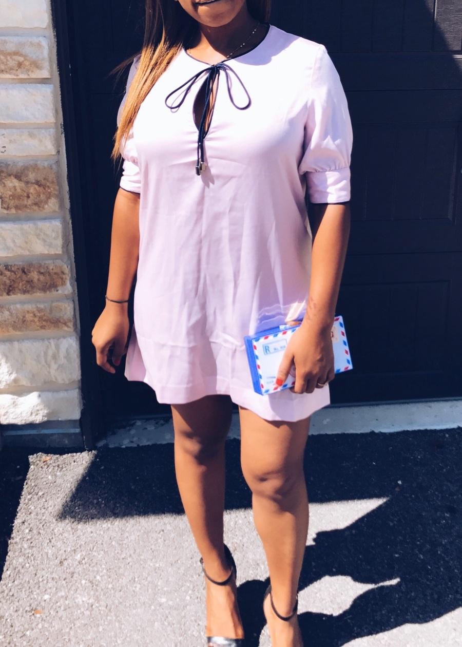 pink satin shift dress with postal clutch