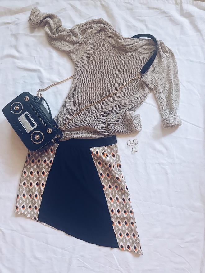sweater with mini skirt and radio handbag
