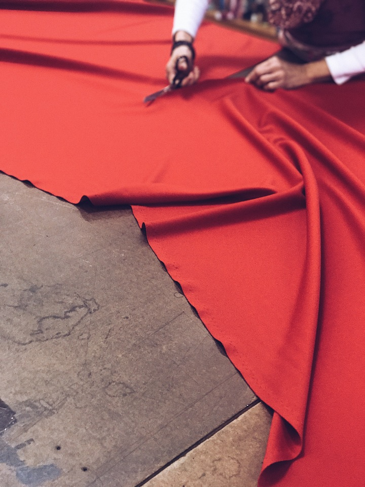 cutting red fabric
