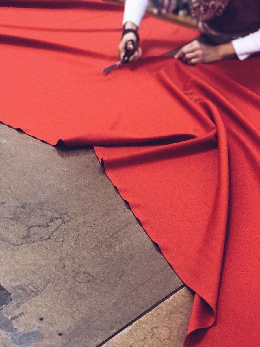 cutting red fabric