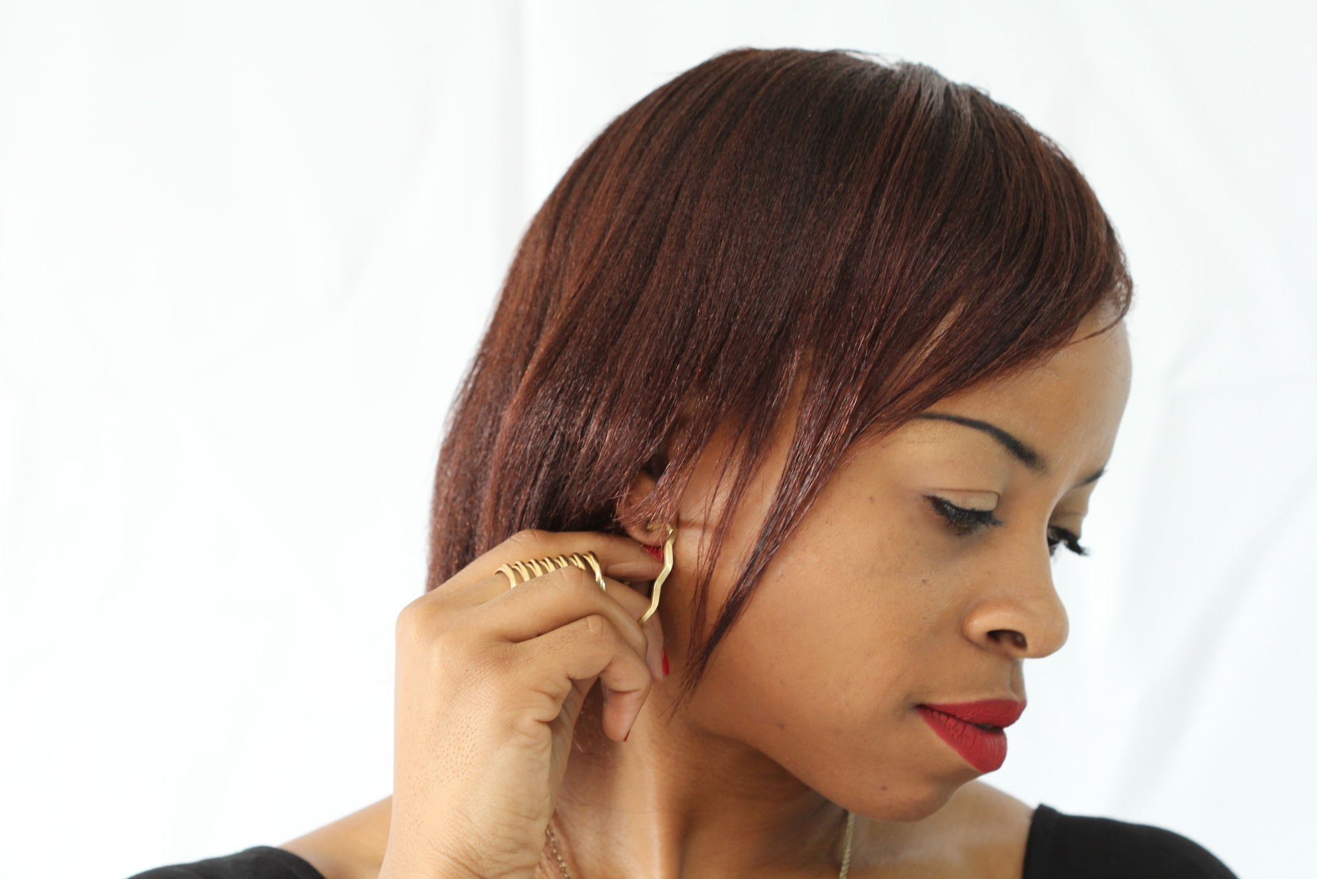 wearing gold earrings