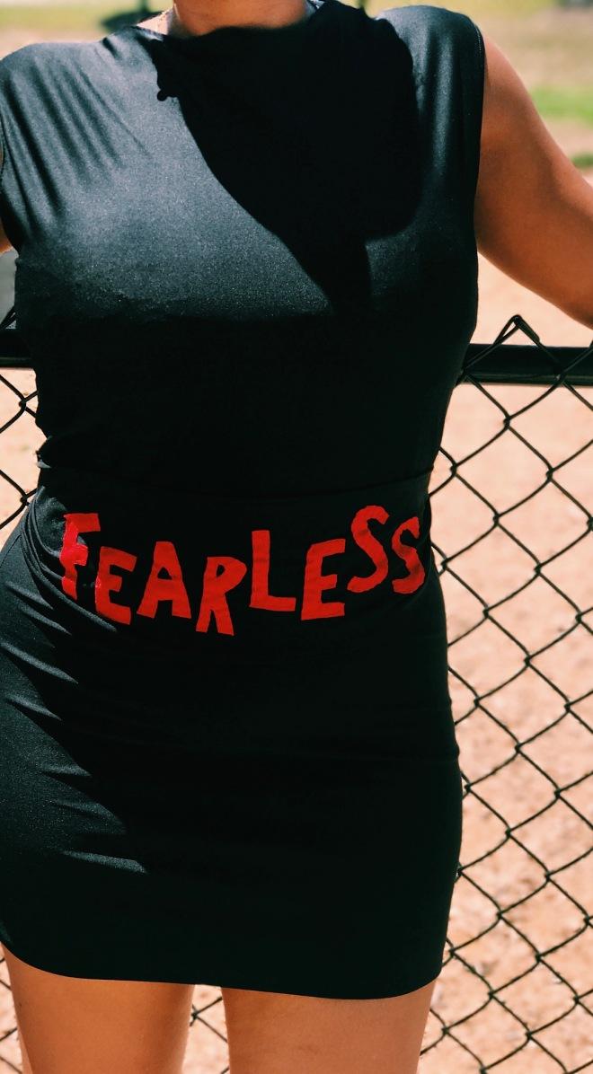 black t-shirt dress with fearless belt