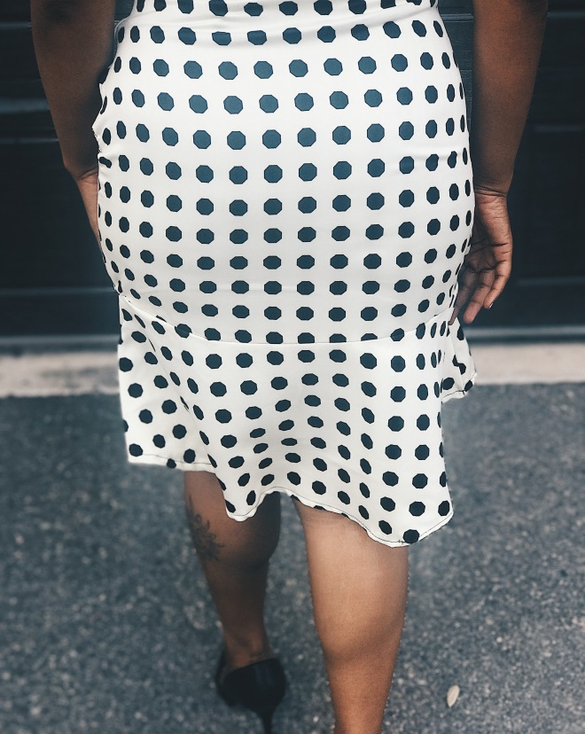 back of polka dot skirt blue labels boutique