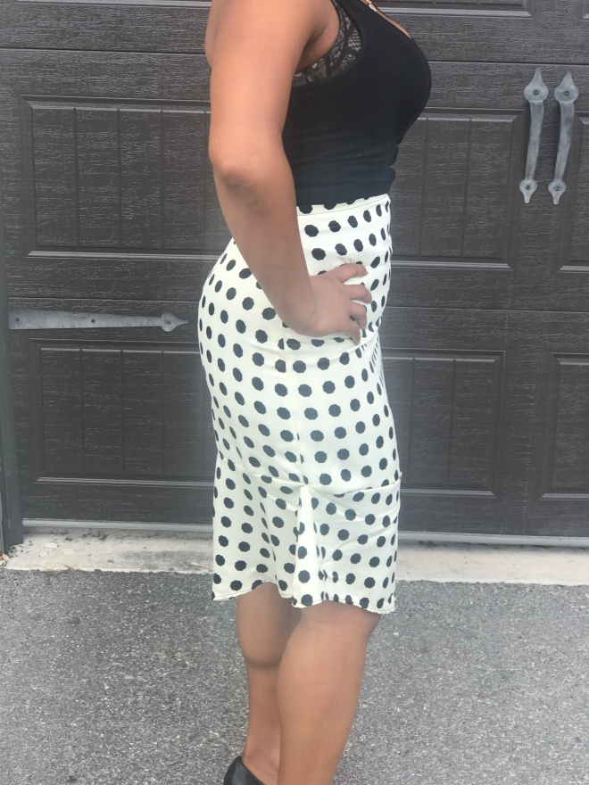 side of polka dot skirt blue labels boutique