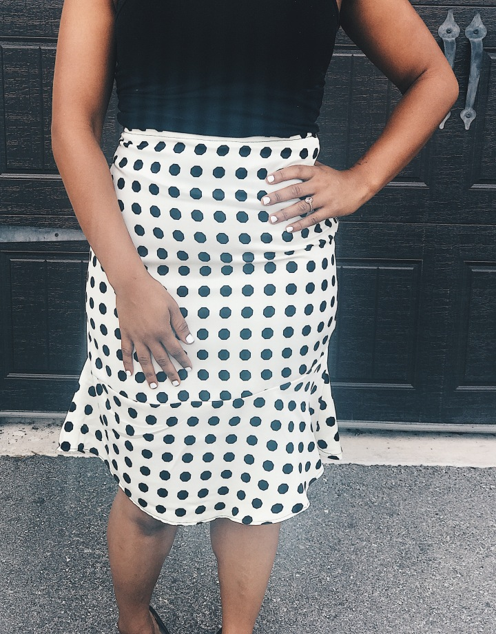 front of polka dot skirt blue labels boutique
