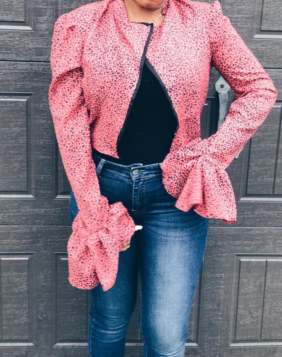 woman wearing pink black animal print blouse open front