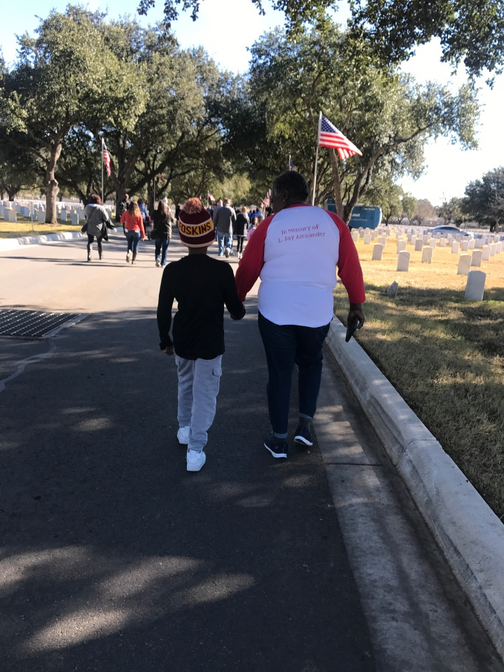 mama and nephew holding hands at cemetery