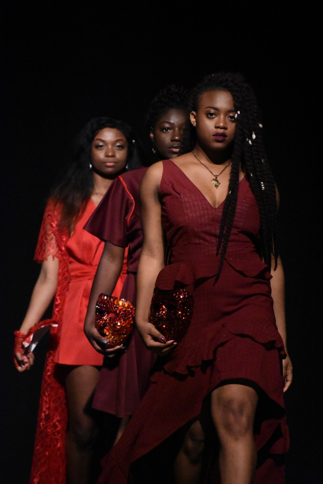 models lined up at runway show